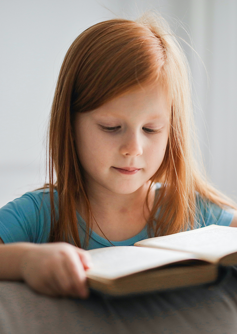 college financial planning in San Diego, CA,  Image of a young girl reading a book