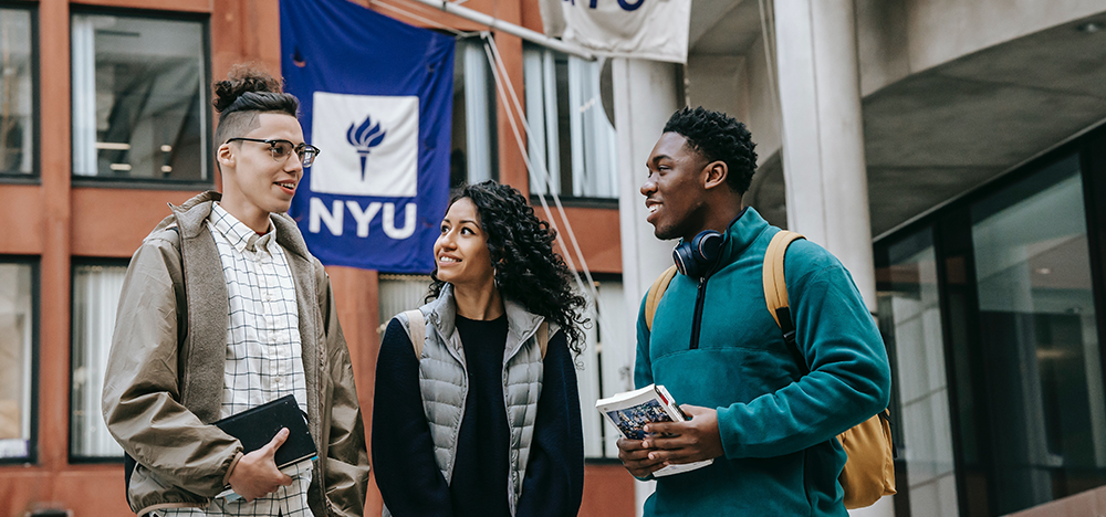 No College Savings? No Problem. 6 Simple Tips to Help Get You on Track, image of college students standing outside of college campus.